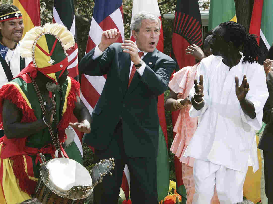 President George W. Bush dances with members of the KanKouran West African Dance Company during a Rose Garden event to mark Malaria Awareness Day at the White House on April 25, 2007.