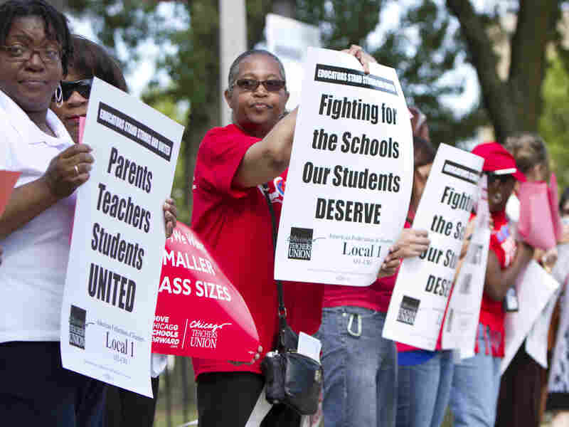 Members of the Chicago Teachers Union hold an informational picket outside Willa Cather Elementary School on Aug. 20 in Chicago. Teachers could go on strike Monday.