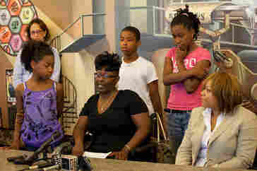 Michelle Johnson and her family talk about conditions within Detroit's Highland Park schools, in July.