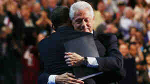 Former President Bill Clinton hugs President Obama onstage after Clinton's rousing speech during the Democratic National Convention on Wednesday in Charlotte, N.C.