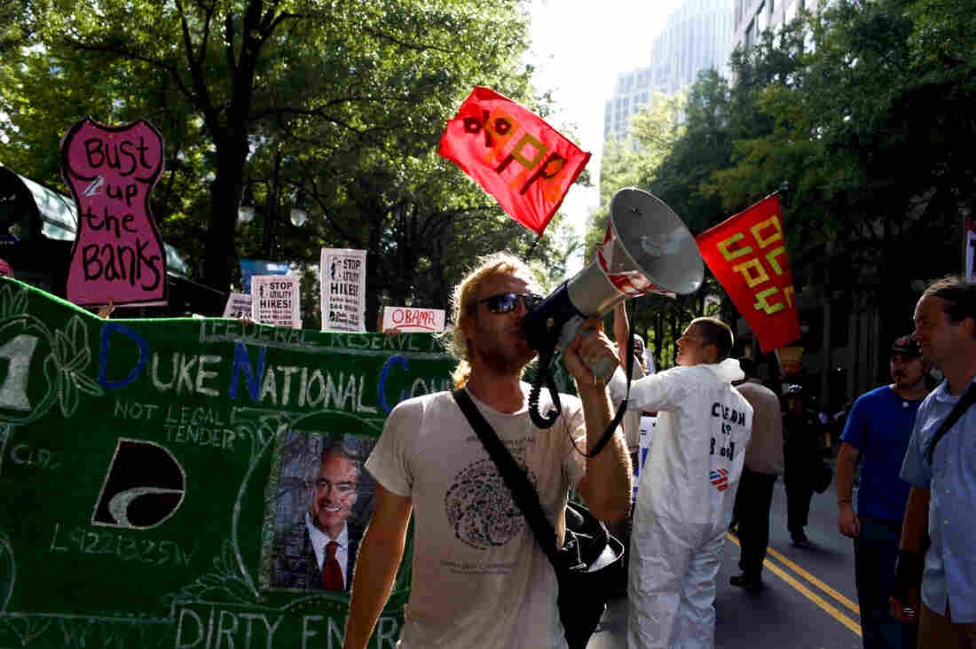 A group of roughly 100 Occupy protestors took to the streets in Charlotte on Wednesday. Occupiers marched relatively peacefully down Tryon St. a few blocks away from the Time Warner Cable Arena.