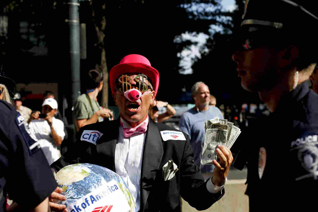 Members of Code Pink dressed as members of the 1 percent to protest.