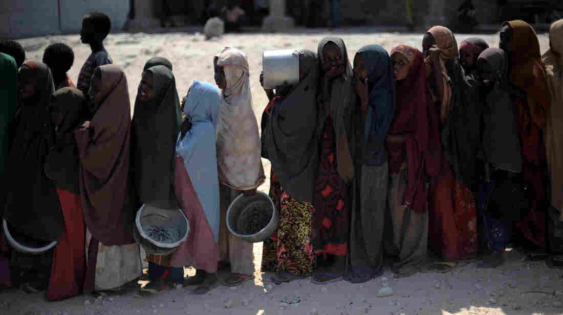 Somali girls line up to receive a hot meal in Mogadishu last y