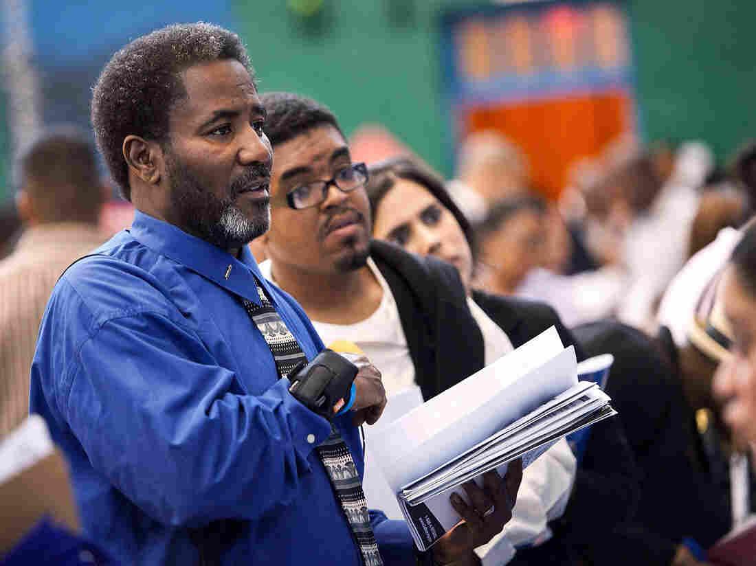 The scene at a job fair in Harlem earlier this summer.