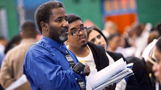 The scene at a job fair in Harlem earlier this summer. (Getty Images)