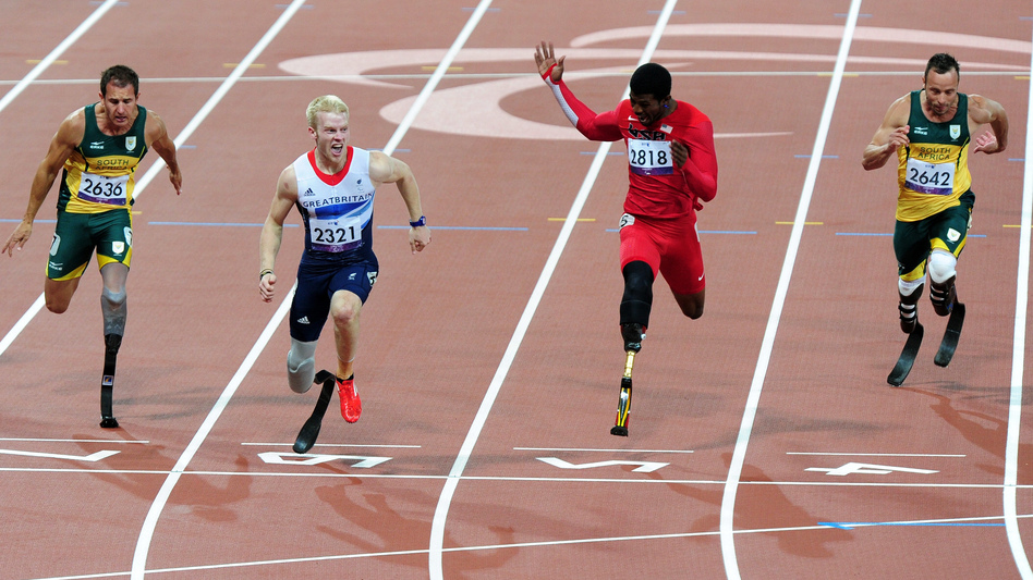Bronze medalist Arnu Fourie of South Africa (from left), gold medalist Jonnie Peacock of Great Britain, silver medalist Richard Browne of the United States and Oscar Pistorius of South Africa cross the line in the Men's 100m - T44 Final at London's Olympic Stadium.