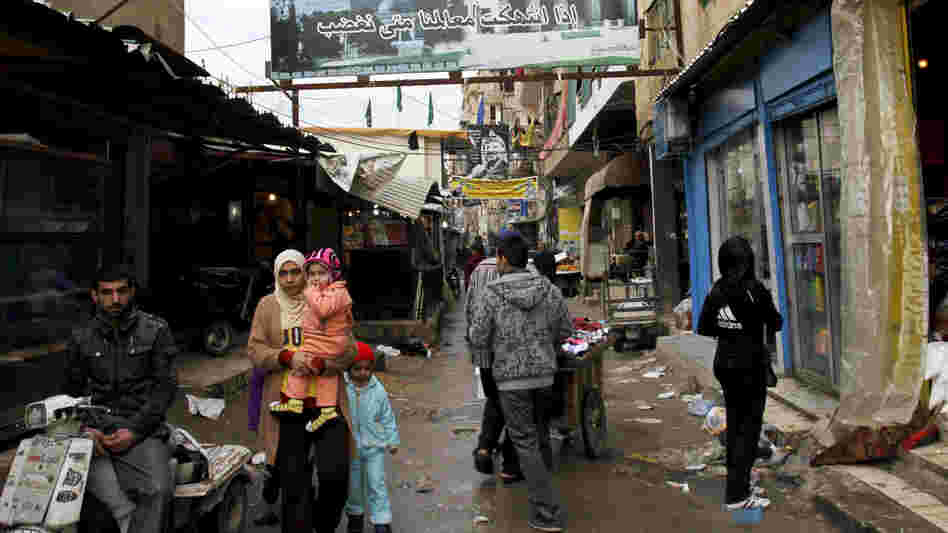 The Palestinian refugee camps in Lebanon are overcrowded and run down. But Syrian refugees are moving in as they flee the fighting in their homeland.