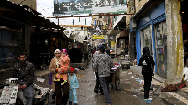 The Palestinian refugee camps in Lebanon are overcrowded and run down. But Syrian refugees are moving in as they flee the fighting in their homeland. (APA/Landov)