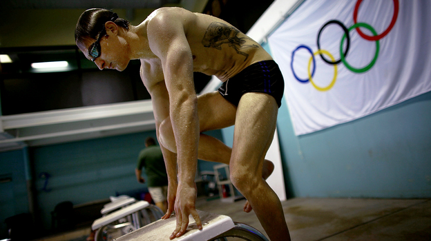 Lt. Brad Snyder mounts the starting blocks while training on his starting technique. Snyder was permanently blinded last year by an IED in Afghanistan, and is now competing in the Paralympics in London. (NPR)