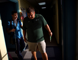 A native of St. Petersburg, Fla., Snyder was captain of the swim team at the U.S. Naval Academy, where he graduated in 2006. Here, he walks with his coach at his training center in Baltimore.