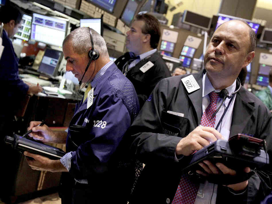 Traders on the floor of the New York Stock Exchange on Aug. 9. Economic developments on both sides of the Atlantic could have a big impact on the U.S. presidential election.