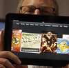 Amazon Kindle vice president Peter Larsen holds the Kindle Fire HD at the introduction of the new tablet in Santa Monica, Calif., on Thursday.