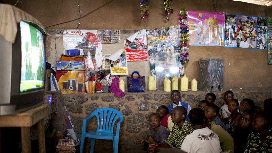 Boys pile into a movie theater  that shows Jackie Chan-style action films dubbed in Swahili, in the town of Rutshuru, eastern Congo. The theater offers a brief respite from tensions outside. (Mackenzie Knowles-Coursin for NPR)