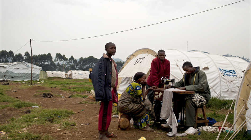 A Congolese man who fled eastern Congo for shelter at a Ugandan refugee camp lugged his sewing machine with him. U.N. officials say tens of thousands have fled  for Uganda and Rwanda in recent months. (Mackenzie Knowles-Coursin for NPR)