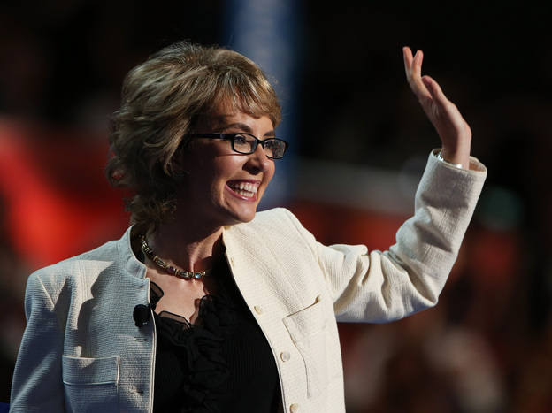 Former Rep. Gabrielle Giffords, D-Ariz., waves to the delegates at the Democratic National Convention.