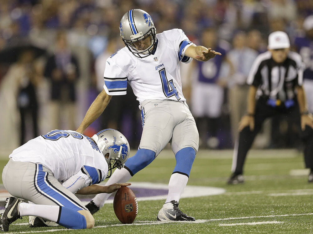 Detroit Lions place-kicker Jason Hanson kicks the ball in an NFL preseason game against the Baltimore Ravens last month. Hanson, 42, has played 21 consecutive seasons for the Lions.