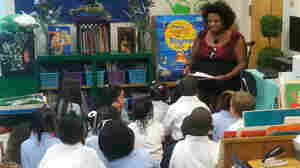 First-grade teacher Euginia Miller reads to her class at Avondale Elementary School in Birmingham, Ala. In this crucible of the civil rights movement, the city's schools are being reintegrated, as a handful of middle-class parents ignore the school district's poor reputation and enroll their kids in the city's public schools.