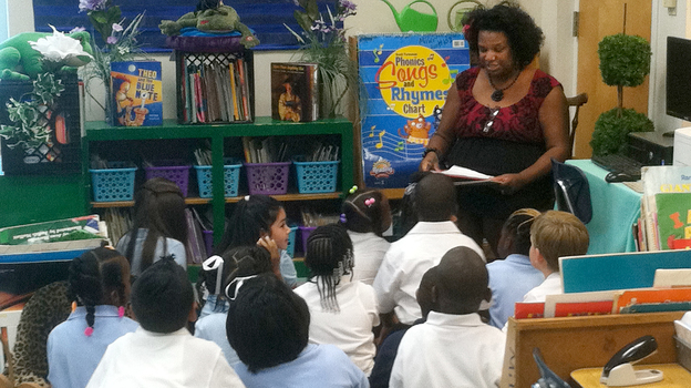 First-grade teacher Euginia Miller reads to her class at Avondale Elementary School in Birmingham, Ala. In this crucible of the civil rights movement, the city's schools are being reintegrated, as a handful of middle-class parents ignore the school district's poor reputation and enroll their kids in the city's public schools. (WBHM)