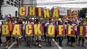 Protesters in Manila, Philippines, marched toward the Chinese consulate during a May rally decrying the standoff between the two nations over the Scarborough Shoal.