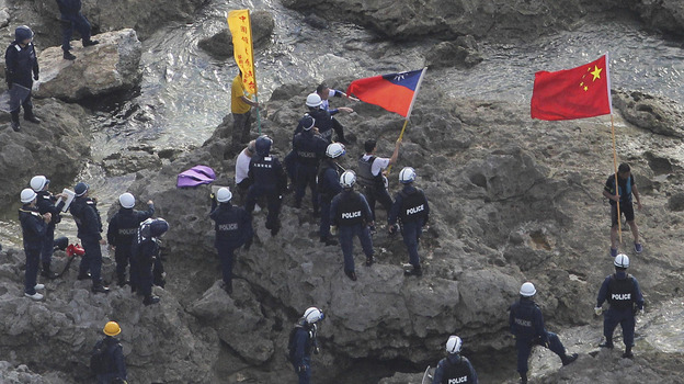 Last month, Japanese police officers arrested activists holding Chinese and Taiwanese flags who landed on Uotsuri Island, one of the islands of Senkaku (in Japanese), which is known as Diaoyu in Chinese. (AP)