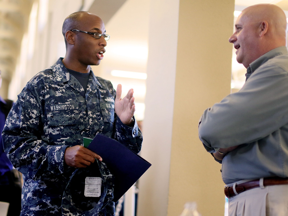 At a job fair in San Diego this week, Navy Sailor E-5 Cedric Washington spoke to Sim Garriotti from Lockheed Martin while interviewing for a potential position.