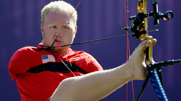 Archer Matt Stutzman of the U.S. prepares to shoot in the London Paralympics. Born without arms, Stutzman uses a release trigger strapped to his shoulder to fire. (Getty Images)