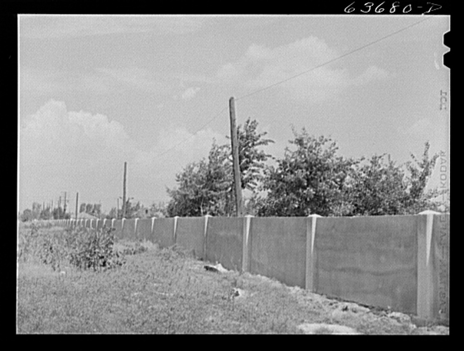 The concrete wall separating the black and white sections of Detroit is seen in 1941. (Courtesy of the Library of Congress)