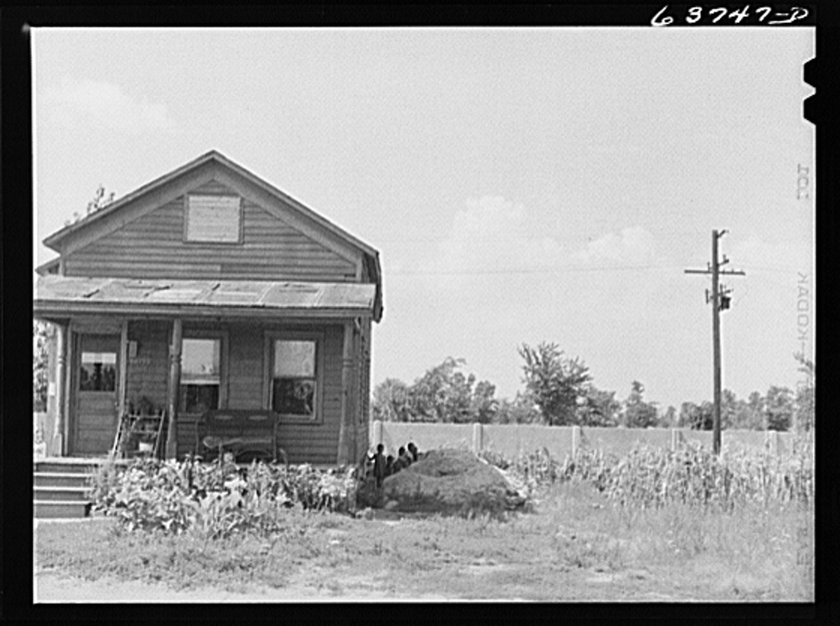 A house in the black section of Detroit in 1941, abutting the wall. (Courtesy of the Library of Congress)