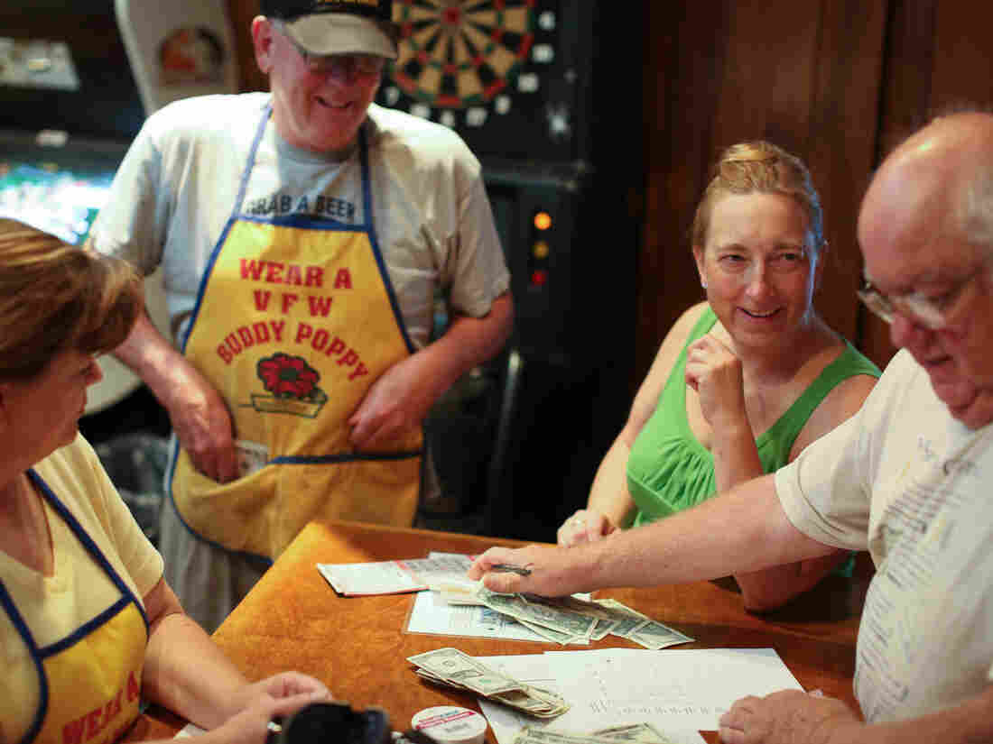 From left, Linda Ausen, Marvin Jansma, Diane Sandberg and David Griffith volunteer during bingo night in July at the VFW post in Rosemount, Minn.