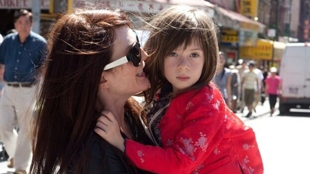 Julianne Moore and Onata Aprile star in What Maisie Knew.