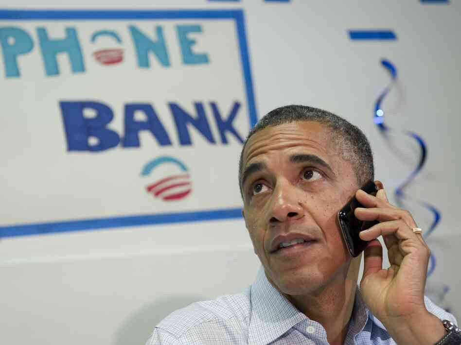 President Barack Obama makes a phone call to a s