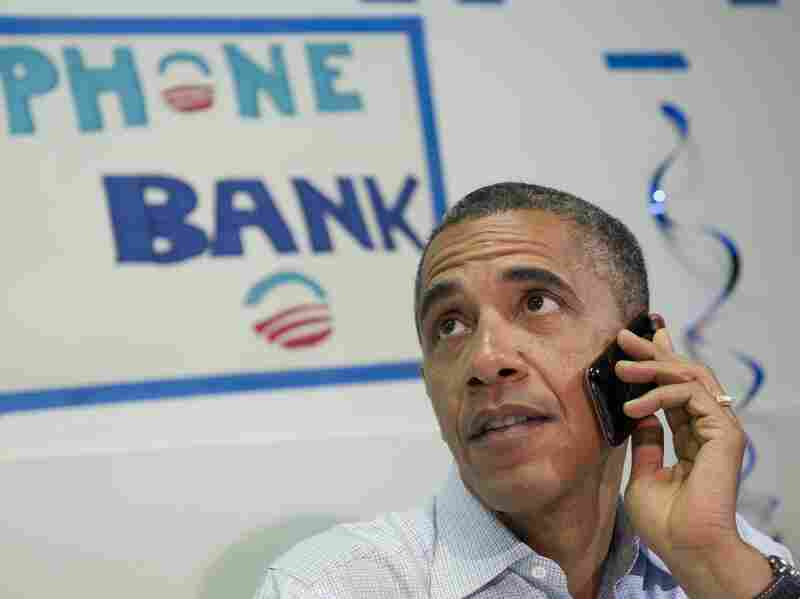 President Barack Obama makes a phone call to a supporter during a visit to the Obama for American campaign field office in Port St. Lucie, Florida, on September 9, 2012, during the second day of a 2-day bus tour across Florida.