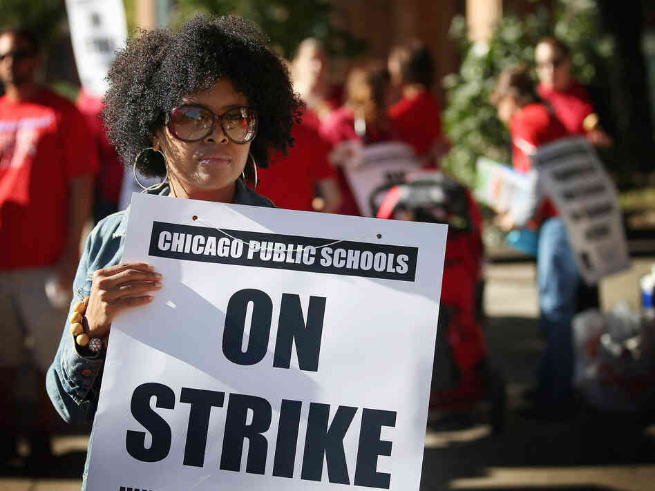 Chicago public school teachers picket outside William H.Wells Community High School on Monday.