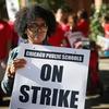 Chicago public school teachers picket outside William H.Wells Community High School on Monday.