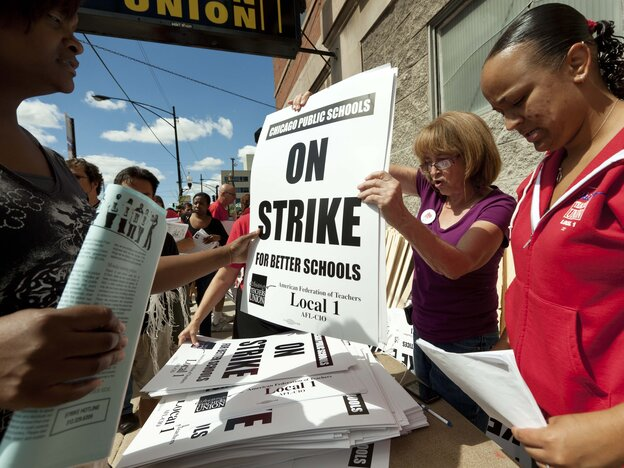 Members of the Chicago Teachers Union distribute strike signage at the Chicago Teachers Union strike headquarters on Saturday, Sept. 8, 2012 in Chicago.
