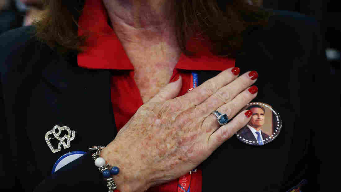 A woman recites the Pledge of Allegiance at the Republican National Convention in Tampa, Fla., on Aug. 29.