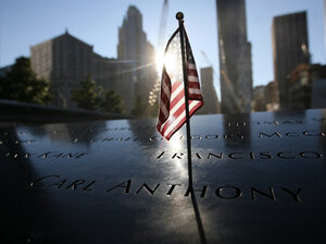 A flag sits atop one of the memorial panels at the World Trade Center site in New York City on Tuesday.