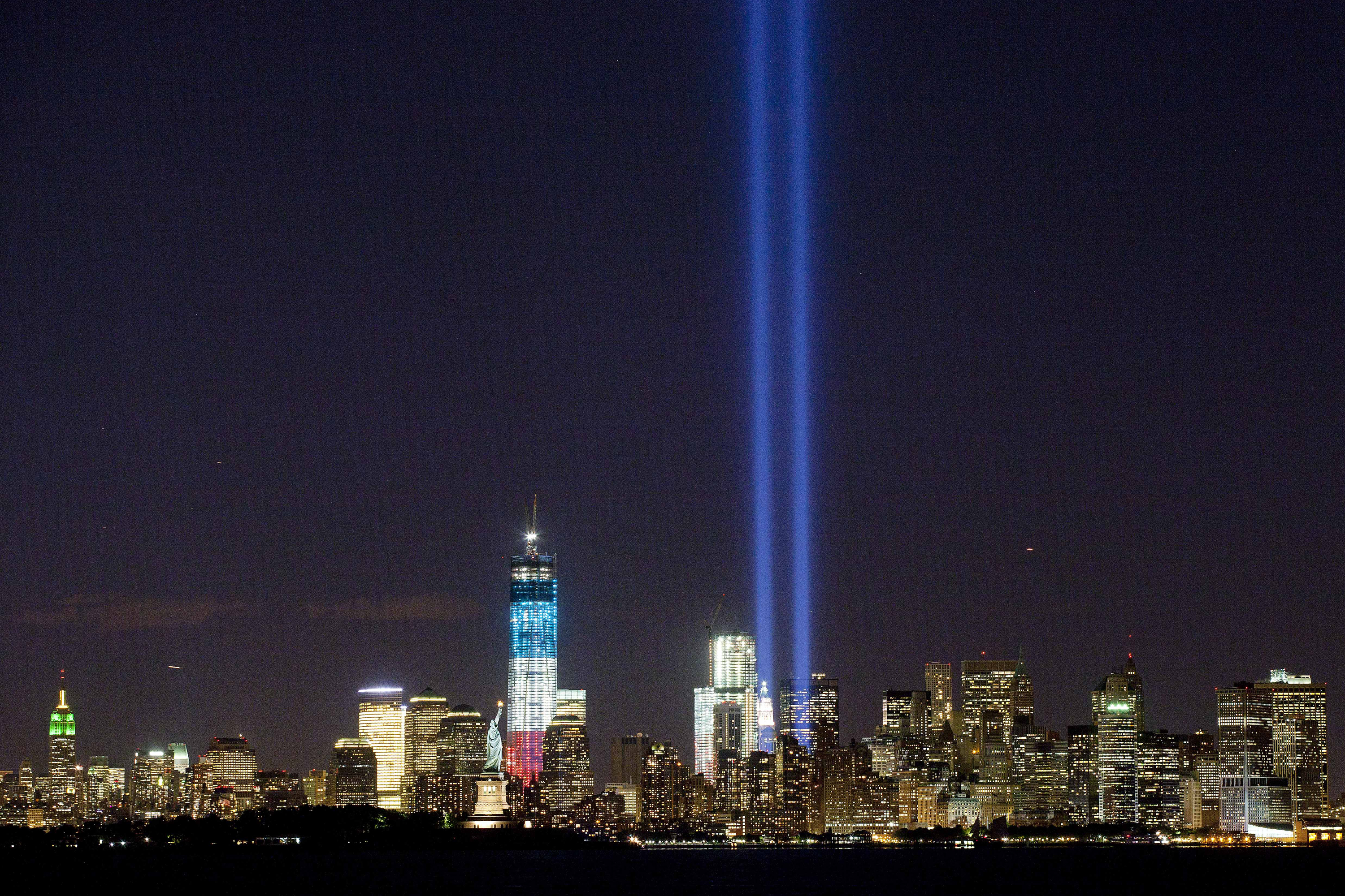 The Tribute in Light shines above the World Trade Center and the Statue of Liberty on Monday as seen from Bayonne, N.J. Tuesday marks the 11th anniversary of the attack that destroyed the twin towers.