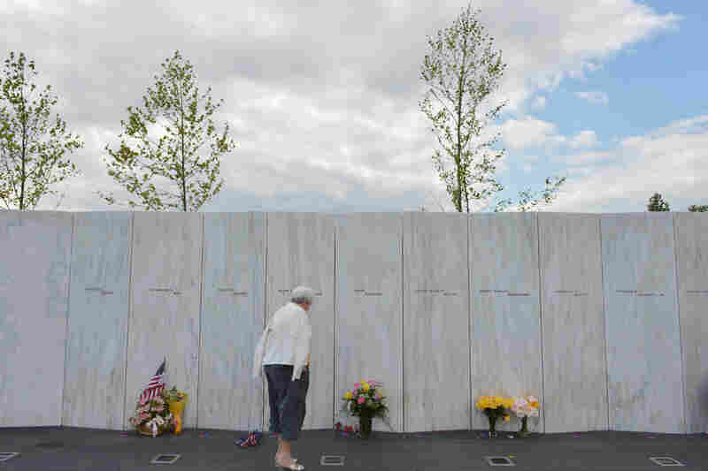 A woman looks at flowers at the Flight 93 National Memorial on Monday ahead of the anniversary of the Sept. 11 attacks in Shanksville, Pa.