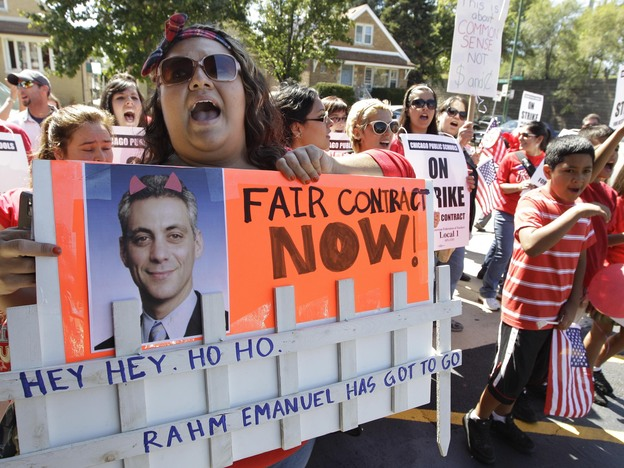 Striking Chicago Public School teacher Lanessa Mendoza pickets with fellow teachers Monday as Mayor Rahm Emanuel visits students staying at Maranatha Church in Chicago during the strike.