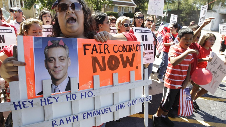Striking Chicago Public School teacher Lanessa Mendoza pickets with fellow teachers Monday as Mayor Rahm Emanuel visits students staying at Maranatha Church in Chicago during the strike. (AP)