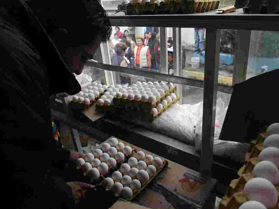 A city worker sells eggs as people line up outside the truck in Mexico City on Aug. 24. The Mexican government is battling an egg shortage that has caused prices to spike in a country with the highest per-capita egg consumption on Earth.