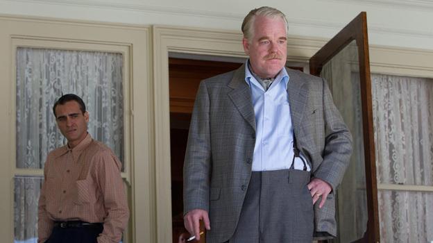 Navy veteran Freddie (Joaquin Phoenix) falls under the influence of cult leader Lancaster Dodd (Philip Seymour Hoffman) in The Master. (The Weinstein Co.)