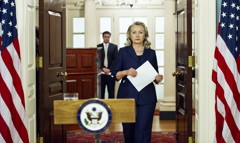 "Secretary of State Hillary Clinton arrives to speak on the killing of Stevens and three staff members. ""This is an attack that should shock the conscience of people of all faiths around the world,"" she said. ""There is no justification ... violence is no way to honor faith."" (AFP/Getty Images)"