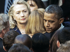 Secretary of State Hillary Clinton looks on as President Obama hugs a State Department employee Wednesday. Obama met with State Department workers after the killing of four Americans in Libya.