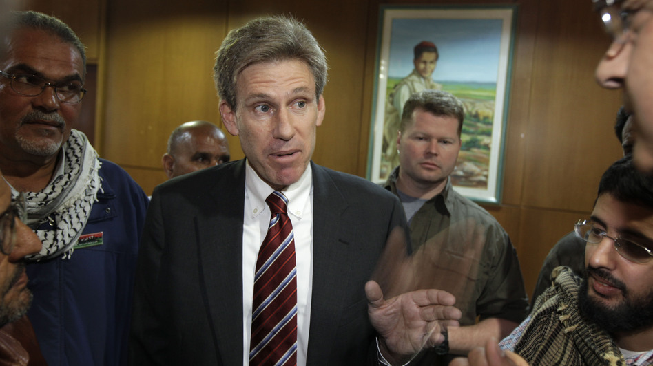 Chris Stevens, the U.S. ambassador who was killed Tuesday in Libya, often chose difficult assignments. He worked closely with Libya's rebels last year when they overthrew Moammar Gadhafi. He's shown here speaking to journalists in Benghazi in April 2011, shortly after the uprising against Gadhafi began. (AP)