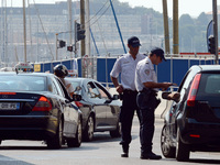 Police officers in Marseille carry out checks on passing cars Sept. 8, two days after the French government announced an increased police presence and the creation of a security zone in the city.