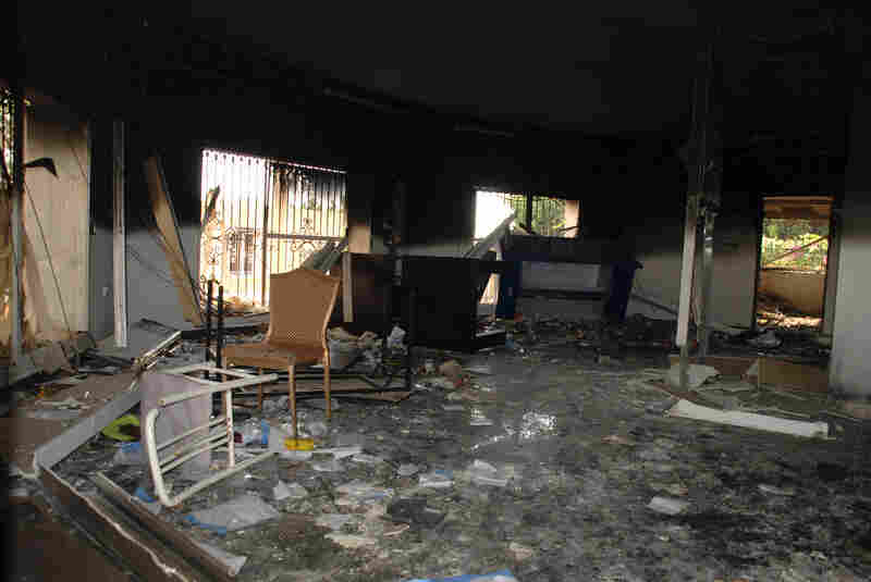 Glass, debris and overturned furniture are strewn inside a room in the gutted U.S. Consulate. Ambassador Stevens died as he and a group of embassy employees went to the consulate to try to evacuate staff as a crowd of hundreds attacked the consulate, many of them firing machine guns and rocket-propelled grenades.