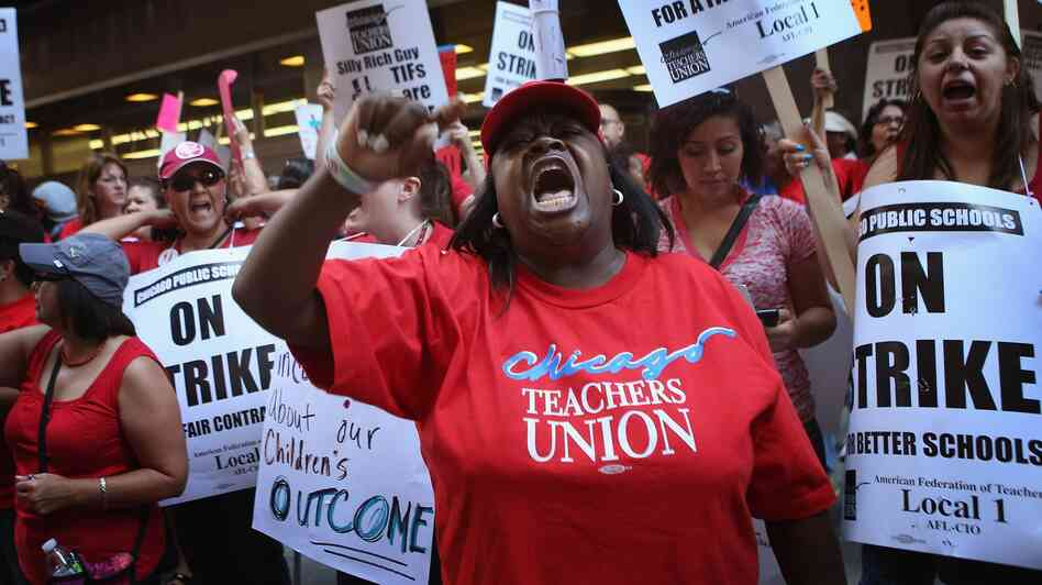 Chicago public school teachers and their supporters picket in