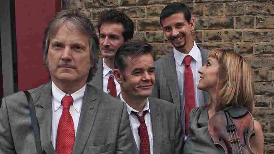 Find the One is the latest album by the alt-bluegrass act The Coal Porters, led by Sid Griffin (far left).